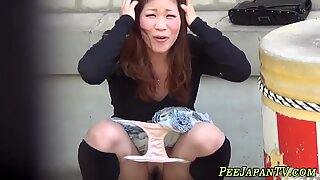 Asian hottie pees outdoor