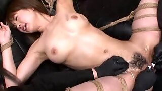 Naked Oriental gets tied down for intense orgasms