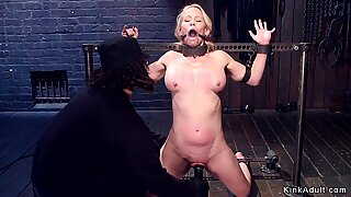 Gagged blonde slave clamped and toyed