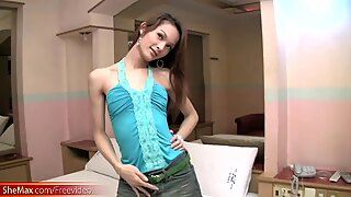 Lovely ladyboy poses in blue satin lingerie and strokes cock
