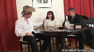 Old lady in stockings double fucked on the table