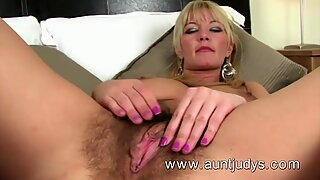 Full-bush big breasted MILF Vanessa masturbates