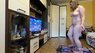 Curvy MILF on a dancing pad