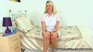 Busty grandma Elle gets naughty in nylons