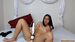 Young Asian doll with sexy glasses fucking hairy pussy