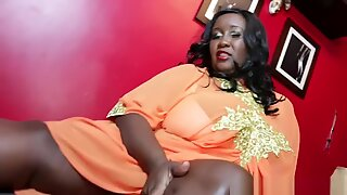 Robust Ebony Mistress Gets Her Feet Worshiped and Pampered