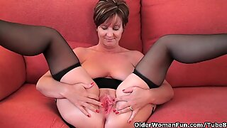 Classy grandma in stockings shows her big tits and pussy