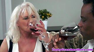 Alluring granny sucking on a huge black dick