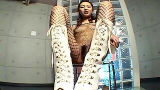 Tall slim and pale whore Asahi Miura provides a dude with a footjob