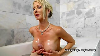 Huge tits Milf wanks huge dick in bathtub