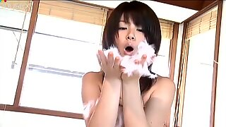Weird chick Airi Nakajima jams her tits and smiles on camera